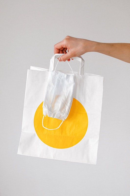 {#person-holding-paper-bag-and-face-mask-3987245}